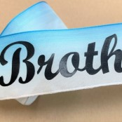 Brother letters on blue satin ribbon